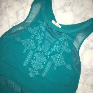 Skies are blue teal sleeveless top Size:LP
